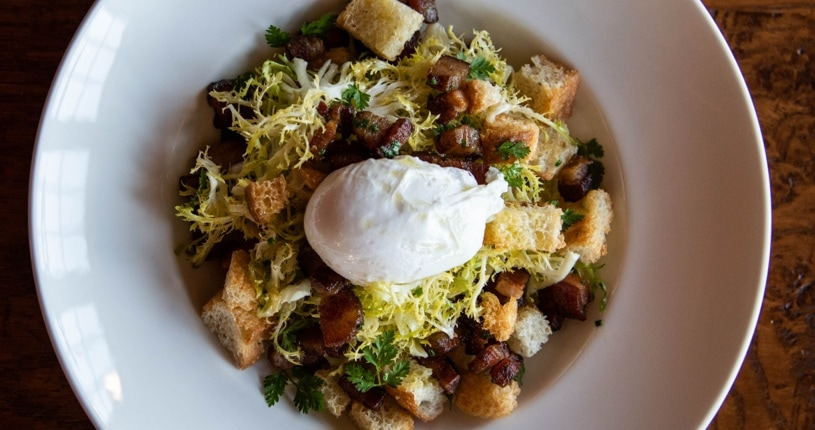 Poached Egg, Bacon and Crouton Frisée Salad